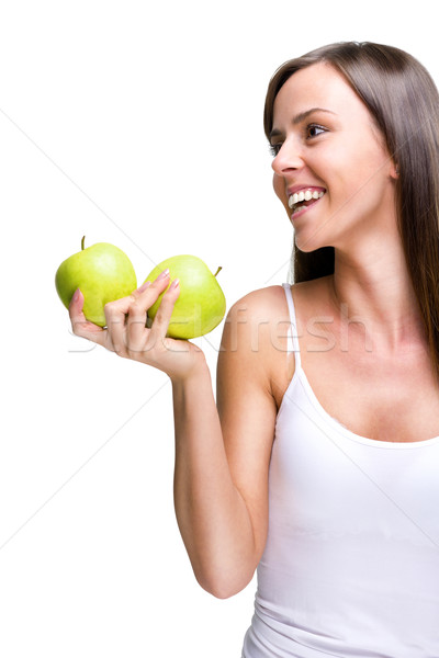 Stock photo: Healthful eating-Lovely woman holding an apple while laughing