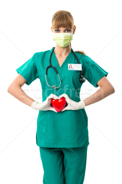 Pretty female surgeon holding a red heart Stock photo © Geribody