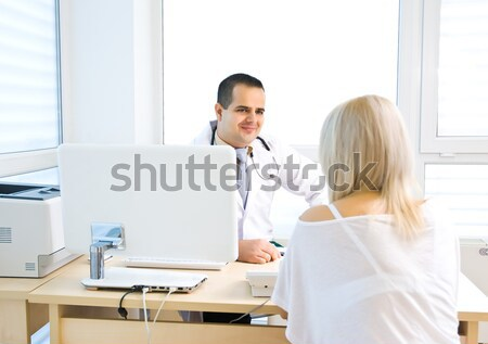 The doctor and the nurse looks at the findings Stock photo © Geribody