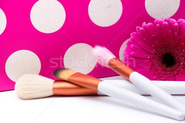 Makeup Brushes on polka dots pink background Stock photo © Geribody
