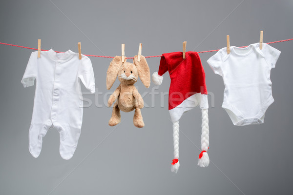 Baby clothes and santa hat on a clothesline Stock photo © Geribody