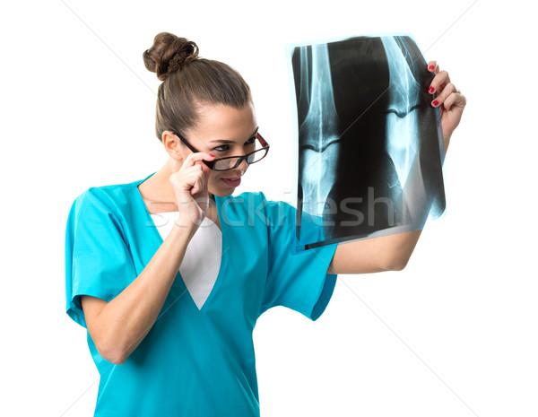 Beautiful radiologist looking at x-ray image Stock photo © Geribody