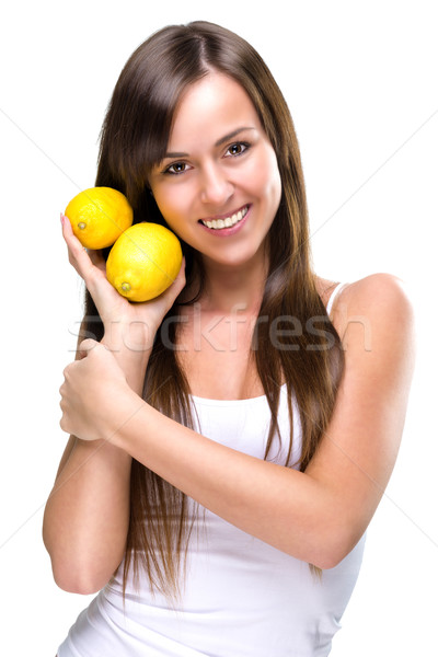 Healthy lifestyle - Beautiful pretty woman is holding two lemons Stock photo © Geribody