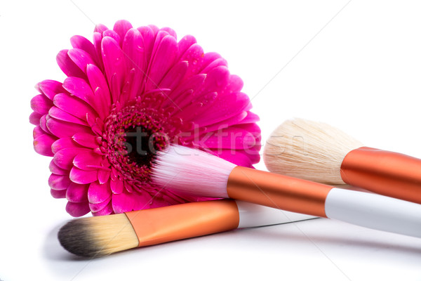 Brushes for make-up  with  big pink flower Stock photo © Geribody