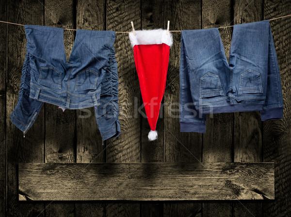 Jeans, santa hat, on clothesline Stock photo © Geribody