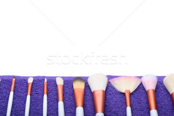 Makeup Brushes set on purple towel Stock photo © Geribody