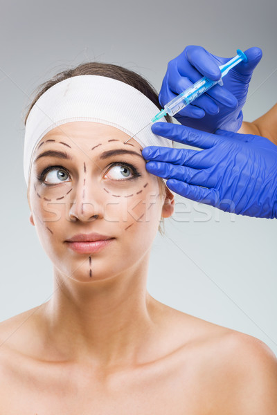 Beautiful woman with plastic surgery, the fear of the needle, a plastic surgeon hands  Stock photo © Geribody