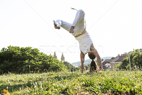 Capoeira woman, awesome stunts in the outdoors Stock photo © Geribody