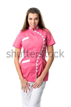 Pretty nurse in pink medical gown Stock photo © Geribody