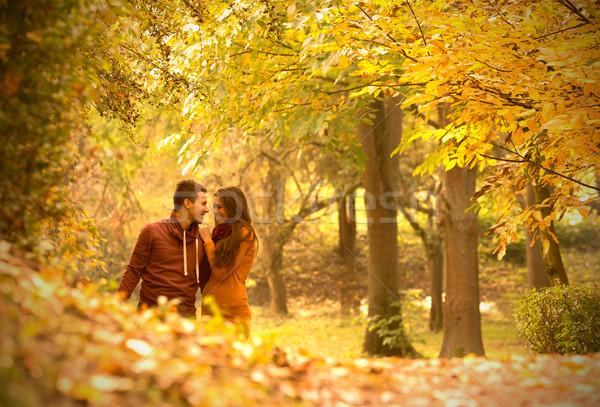 страстный любви осень парка небе девушки Сток-фото © Geribody