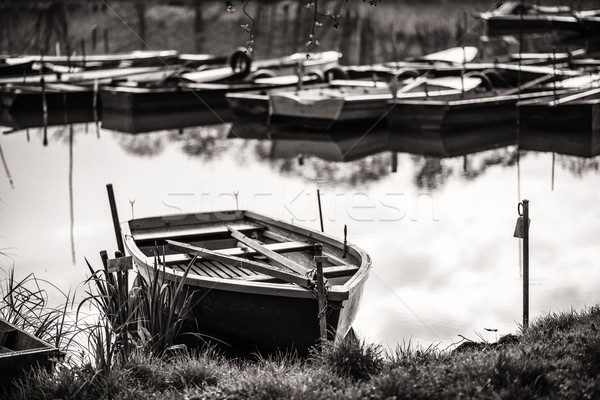 Boat Harbour - in black and white wood boats on the lake Stock photo © Geribody