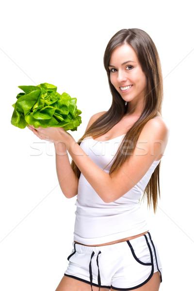 Healthful eating-Beautiful fit woman holding a salad. Stock photo © Geribody