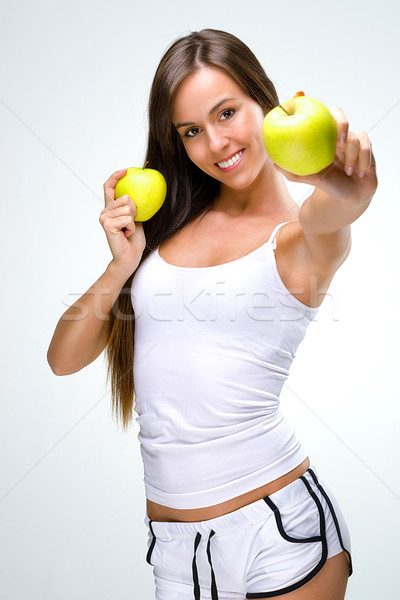 Eat healthily - Beautiful woman shows the apples  Stock photo © Geribody