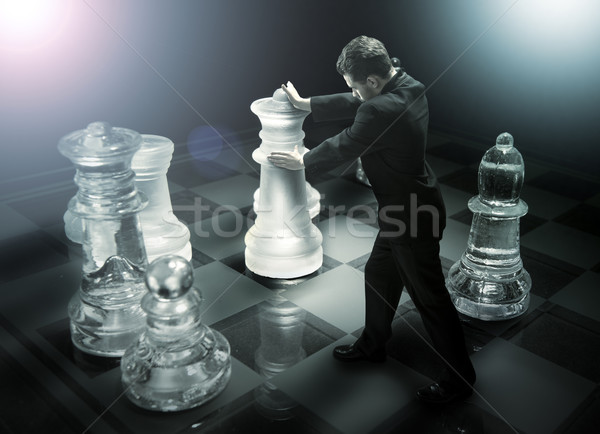 Businessman on a chessboard as a dummy Stock photo © Geribody