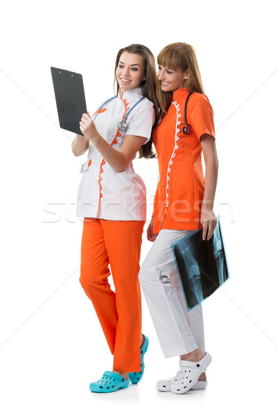2 pretty nurse looking at the x-ray findings Stock photo © Geribody