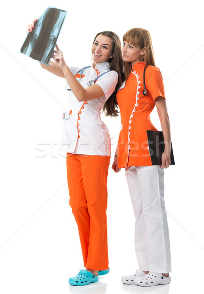 Two doctor  watching X Ray image Stock photo © Geribody