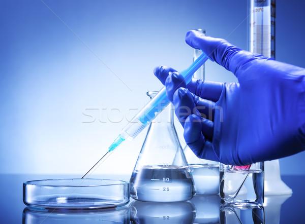 Laboratory equipment, syringe in hand glass bowl Stock photo © Geribody