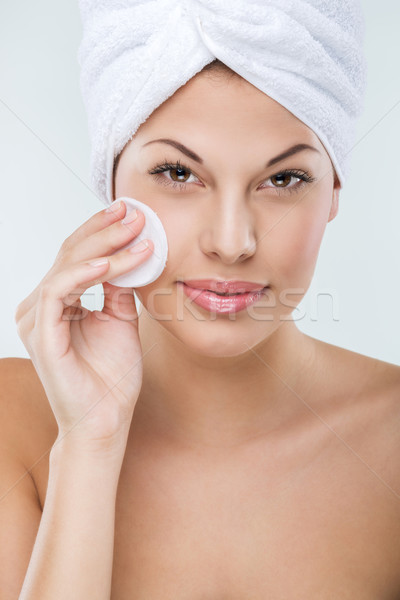 Beautiful woman with perfect skin clean face towel on her head Stock photo © Geribody
