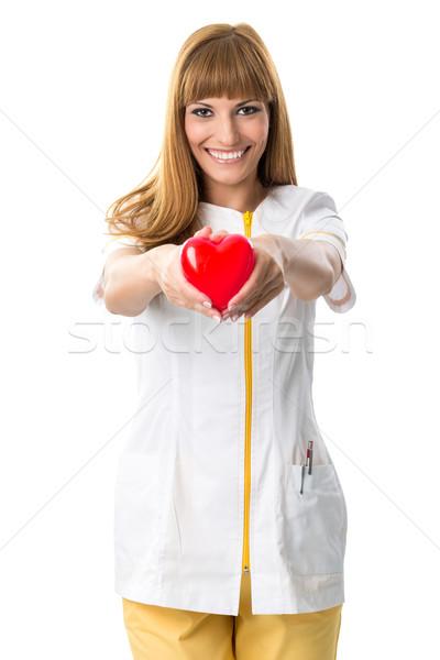 Güzel hemşire kırmızı kalp doktor Stok fotoğraf © Geribody