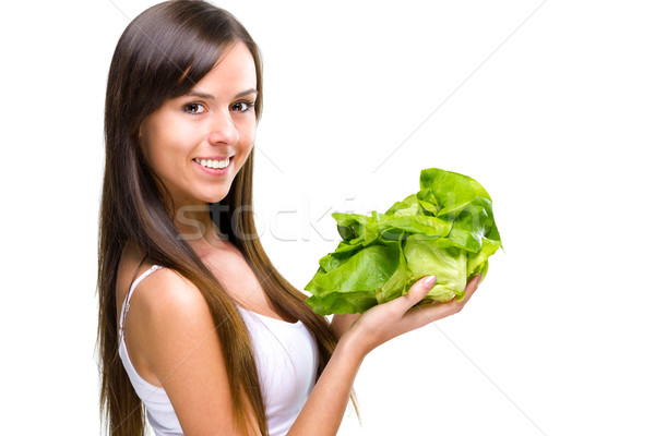 Stock photo: Healthful eating-Beautiful fit woman holding a salad.