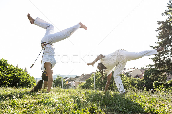 Capoeira couple of awesome stunt outdoors  Stock photo © Geribody