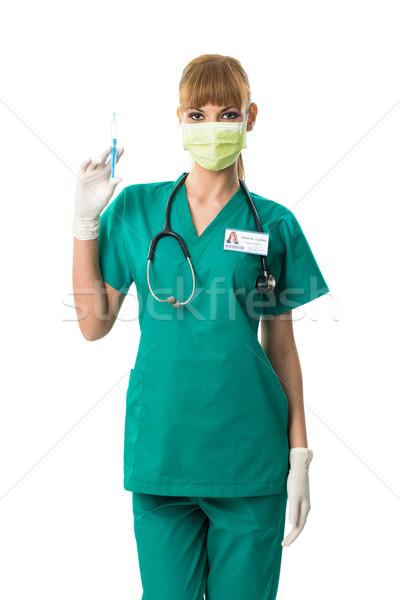 Hermosa femenino cirujano boca máscara inyección Foto stock © Geribody