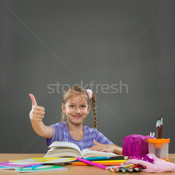 Happy little girl in the school bench shows all okay  Stock photo © Geribody