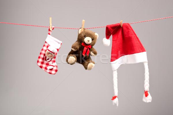 Santa bags, teddy bear and santa hat on a clothesline Stock photo © Geribody