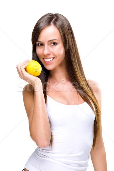Stock photo: Healthful eating-a beautiful woman holding the oranges