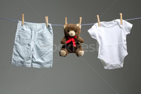 Baby boy clothes, a teddy bear on the clothesline Stock photo © Geribody