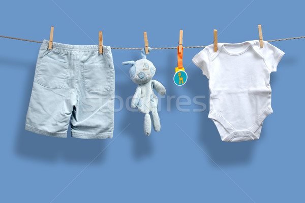 Baby boy clothes on the clothesline Stock photo © Geribody