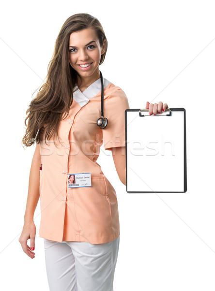 Güzel hemşire Klasör doktor mutlu Stok fotoğraf © Geribody