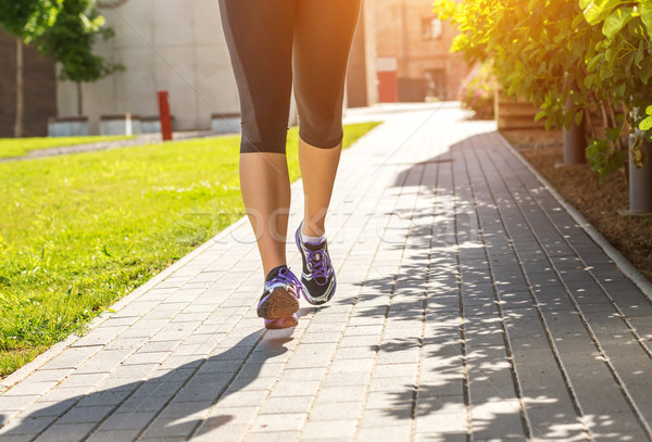 Running woman in black sports outfit (half body photo) on the sidewalk  Stock photo © Geribody