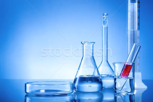 Laboratuvar cam kırmızı sıvı mavi Stok fotoğraf © Geribody