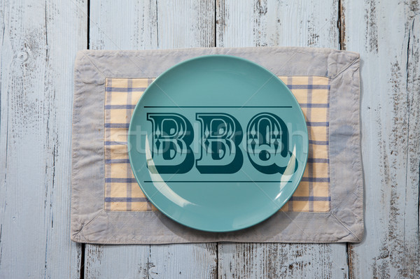 Empty plate with BBQ icon on light blue wooden background Stock photo © gigra