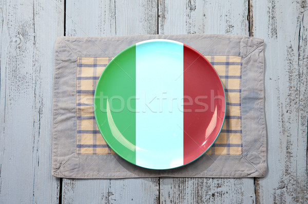 Empty plate with Italian flag on light blue wooden background Stock photo © gigra