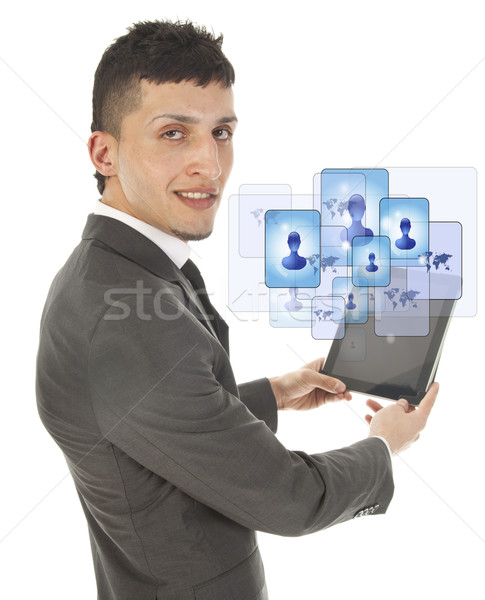 Young man holding a black tablet with social friends isolated on white Stock photo © gigra