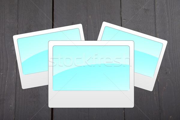 Illustration of empty blue photo frames on dark black wooden background Stock photo © gigra