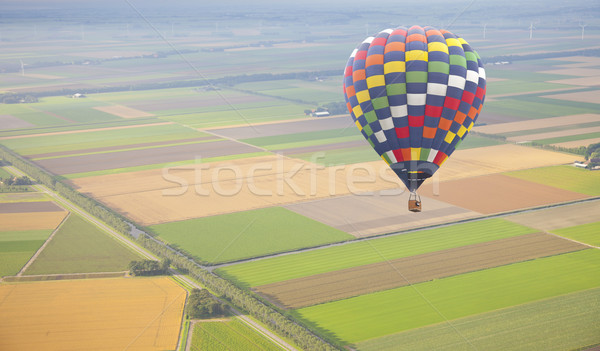 Hot air balloon with green Dutch landscape from above Stock photo © gigra