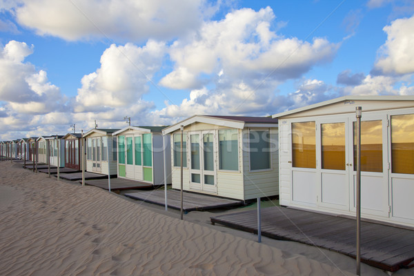 Several beachhouses in a row on beach in The Netherlands Stock photo © gigra