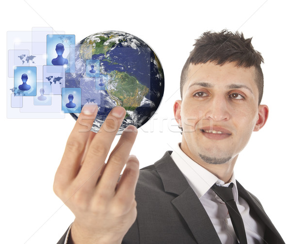 Young man holding earth with social media symbols isolated on white Stock photo © gigra