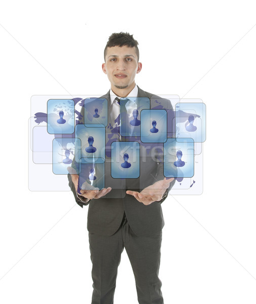 Young man holding social media symbols isolated on white Stock photo © gigra