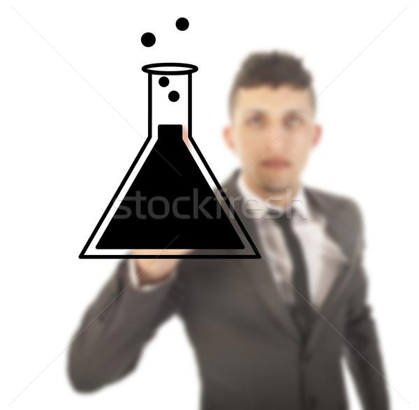Jeunes Homme étudiant science tube isolé Photo stock © gigra