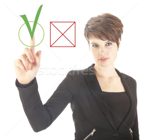 Jonge zakenvrouw kiezen ja geen geïsoleerd Stockfoto © gigra
