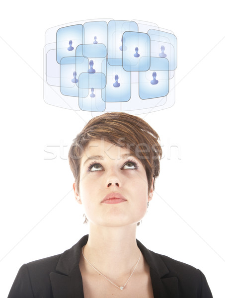 Young woman looking at her virtual friends isolated on white Stock photo © gigra