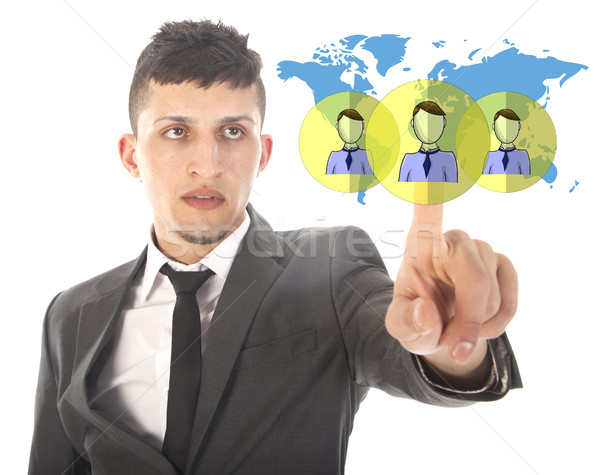 Young businessman with virtual worldwide friends isolated on white background Stock photo © gigra