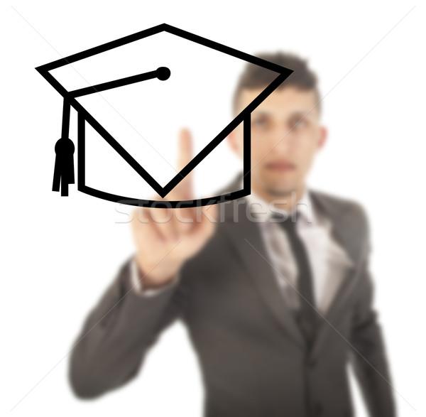 Genç öğrenci siyah şapka yalıtılmış beyaz Stok fotoğraf © gigra