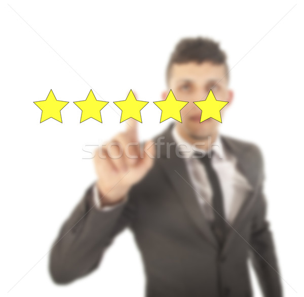 Young man with five stars isolated on white background Stock photo © gigra