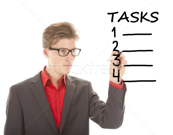Young student writing tasks items isolated on white background Stock photo © gigra