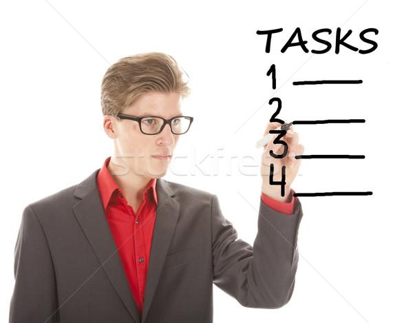 Jovem estudante escrita tarefas isolado branco Foto stock © gigra
